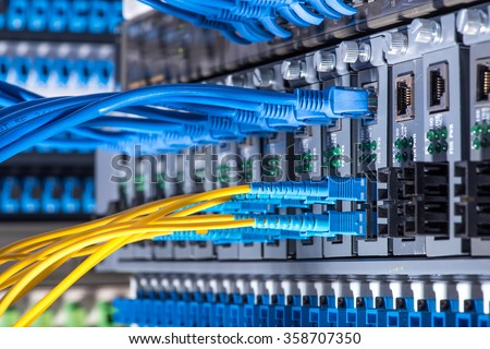 Fiber optic connecting on core network swtich Royalty-Free Stock Photo #358707350