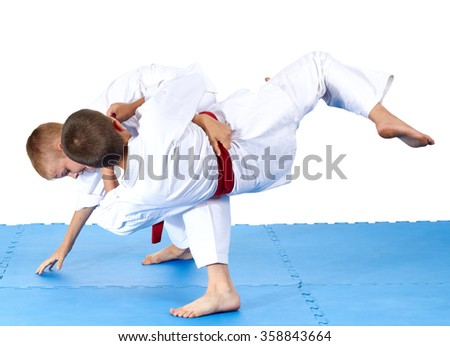 Two sportsmens are training judo throws #358843664