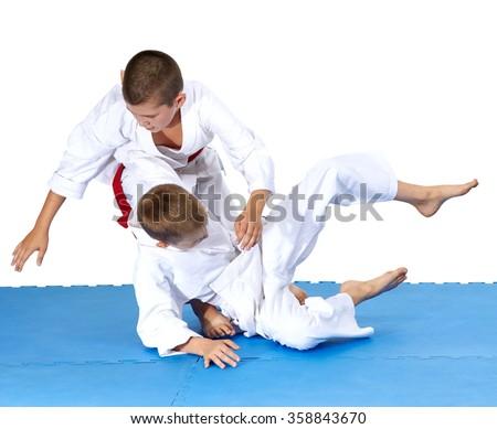Children are training throws of judo in judogi #358843670
