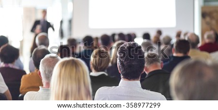 Speaker Giving a Talk at Business Meeting. Audience in the conference hall. Business and Entrepreneurship. Panoramic composition suitable for banners. Royalty-Free Stock Photo #358977299