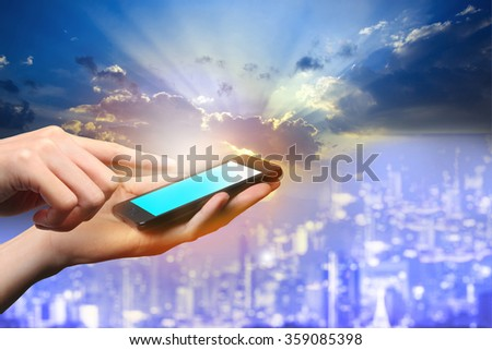 Concept of smart phone useing in city. Closed up hands of man touch screen.  #359085398