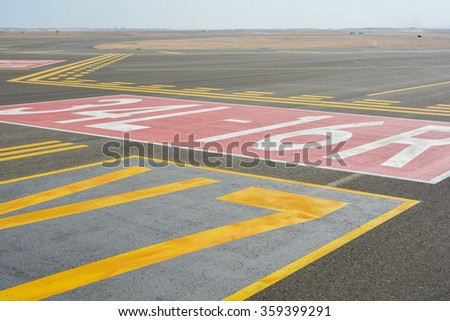 landing light Directional sign markings on the tarmac of runway at a commercial airport #359399291