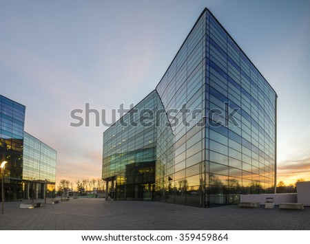 Modern office building in the evening Royalty-Free Stock Photo #359459864