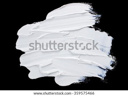 Oil paint strokes isolated over the black background