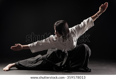 Young, beautiful girl practicing Aikido  Royalty-Free Stock Photo #359578013
