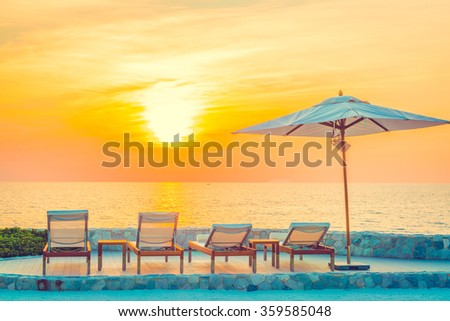 Beautiful luxury hotel swimming pool resort with umbrella and chair - Vintage filter #359585048