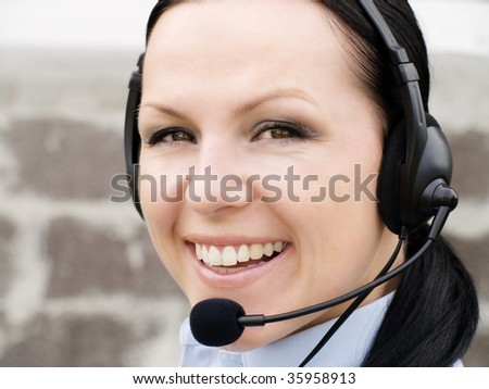 smiling brunette woman with headphone #35958913