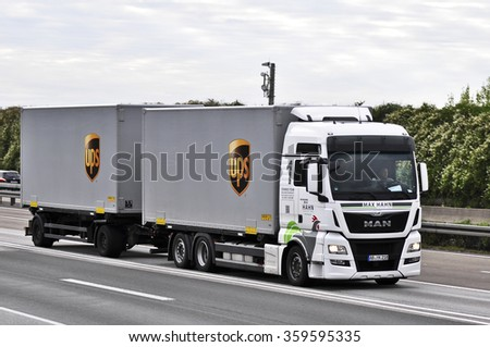 FRANKFURT,GERMANY-OCT 08:truck of UPS on the highway on October 08,2015 in Frankfurt,Germany.UPS is the world's largest package delivery company and a provider of supply chain management solutions. #359595335