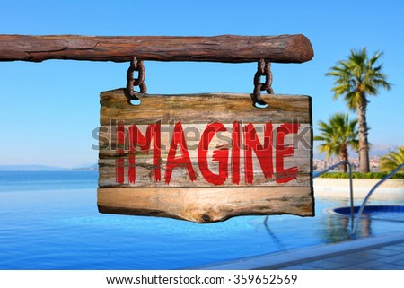Imagine motivational phrase sign on old wood with blurred background #359652569