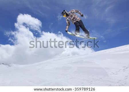 Flying snowboarder on mountains. Extreme sport. #359789126