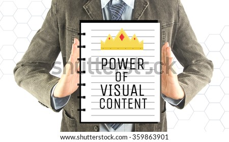 business man with notebook word power of visual content (business concept)