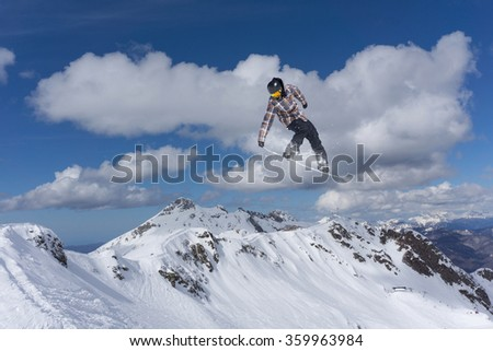 Flying snowboarder on mountains. Extreme sport. #359963984