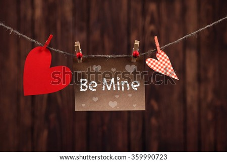 Red hearts and blank note, on wooden background #359990723