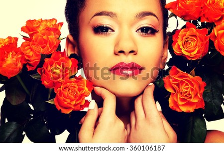 Beauty african woman with roses. #360106187