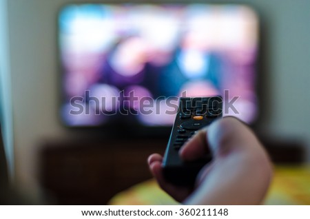 tv control in the hand Royalty-Free Stock Photo #360211148