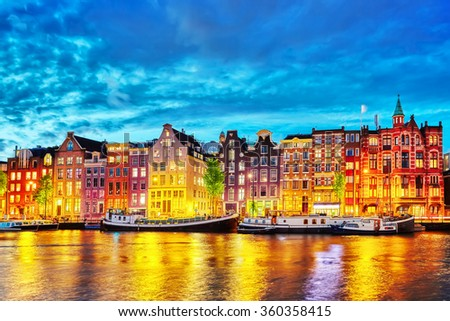Famous Amstel river and night view of beautiful Amsterdam city. Netherlands #360358415