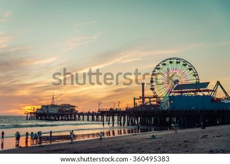 Santa Monica pier at sunset, Los Angeles Royalty-Free Stock Photo #360495383