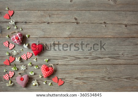 Wooden background with red hearts and flowers #360534845
