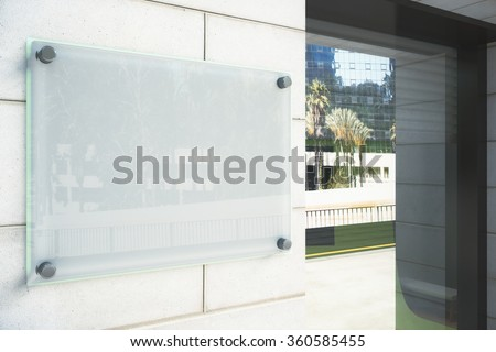 Blank glassy signboard on the wall outdoor, mock up