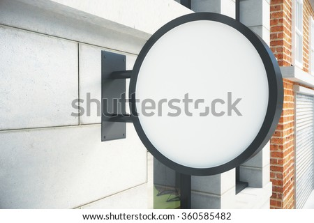 Blank round white signboard on the wall outdoor, mock up