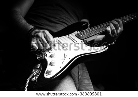 Young man playing electric guitar. Music, instrument education, entertainment, rock star, music concert   and learning concept #360605801