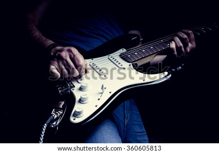 Young man playing electric guitar. Music, instrument education, entertainment, rock star, music concert   and learning concept #360605813