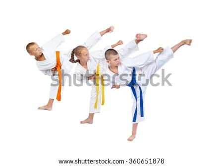 Three athletes are beating kick leg #360651878