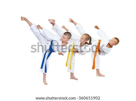 In karategi three athletes beats kick leg #360651902