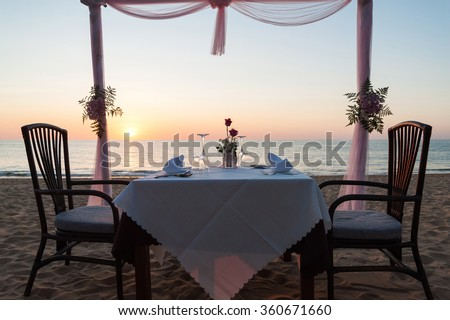 romantic dinner setup ,on the beach with sunset #360671660