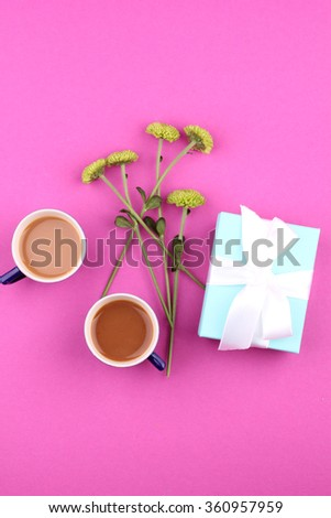 Gift box with flowers on pink background #360957959