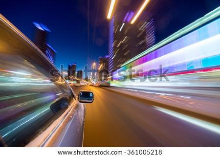 blurred urban look of the car movement nights longexposure #361005218