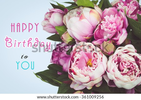 Happy Birthday text card with pink Peony flowers. Blue background.