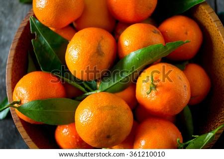 mandarines in a wooden bowl #361210010