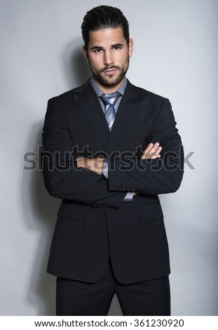 handsome young man in suit on grey background. Business man #361230920
