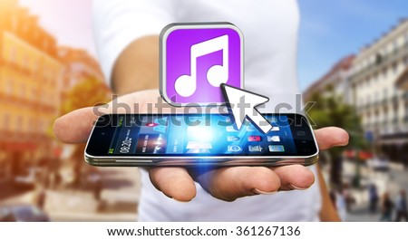 Young man with modern mobile phone in his hand using modern music application #361267136
