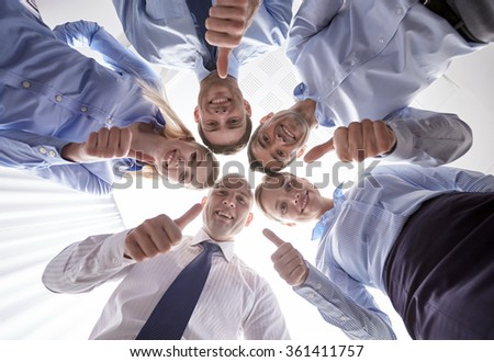 smiling group of businesspeople standing in circle #361411757