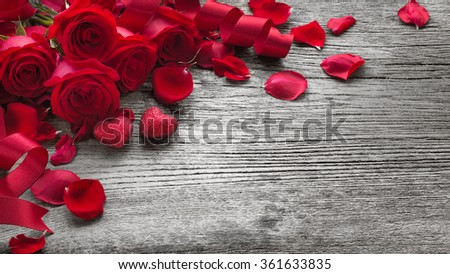 Roses on rustic wooden board,Valentines Day background.