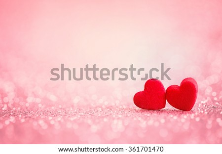 The red Heart shapes on abstract light glitter background in love concept for valentines day with sweet and romantic moment