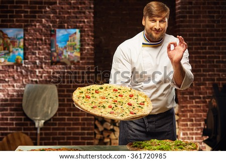 Chef is cooking the best pizza in the world