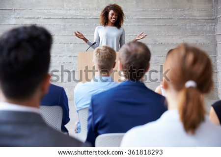 Businesswoman Addressing Delegates At Conference Royalty-Free Stock Photo #361818293