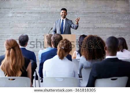Businessman Addressing Delegates At Conference Royalty-Free Stock Photo #361818305