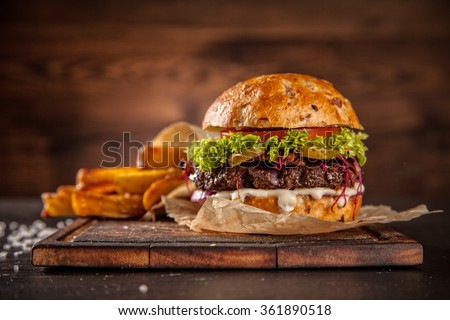 Home made hamburger with lettuce and cheese #361890518