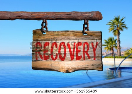 Recovery motivational phrase sign on old wood with blurred background #361955489