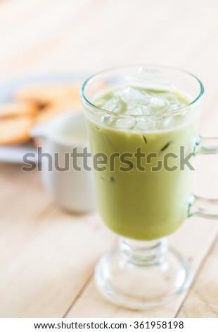 iced matcha latte on wood background #361958198