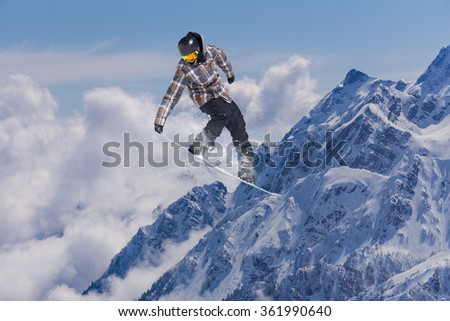 Flying snowboarder on mountains. Extreme sport. #361990640