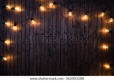 Light bulbs on dark Wooden Background real image