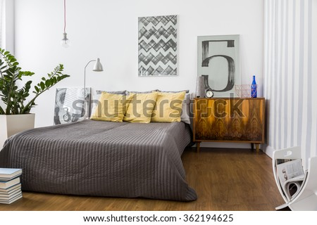 Comfortable double bed in modern stylish bedroom #362194625