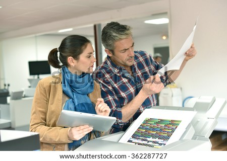 Client in printshop controlling work before final printing #362287727