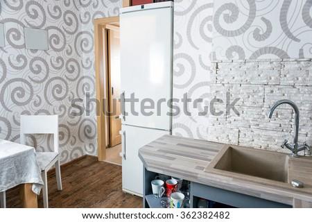 Modern simple kitchen interior design in light apartments #362382482