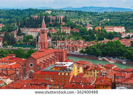 Aerial view over Santa Anastasia Church and red roofs  in cloudy summer day, Verona, Italy #362400488